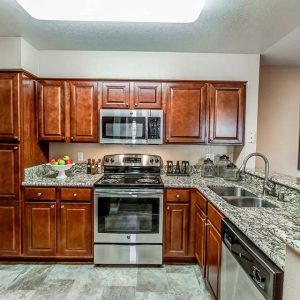 Model unit kitchen featuring modern finishes, and appliances.