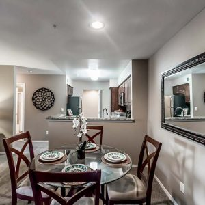 Model unit dining room and kitchen featuring modern finishes, and appliances